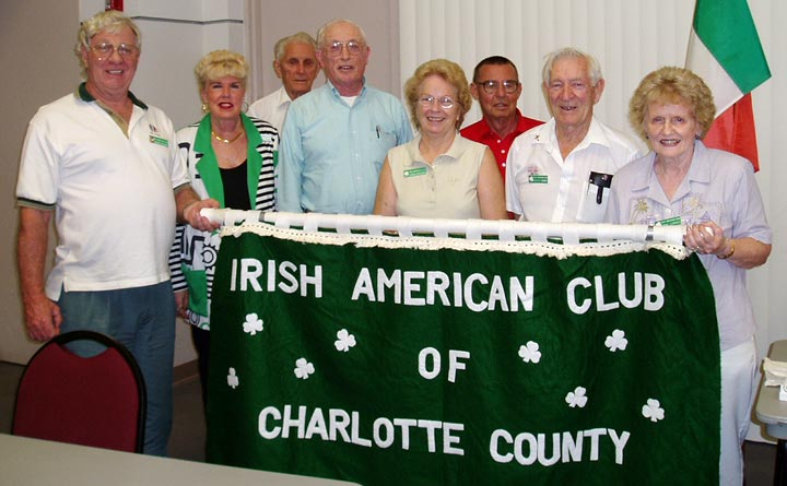 smiling irish club members standing 